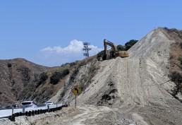 Excavator on hill