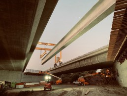 Photo of girder being placed by crews