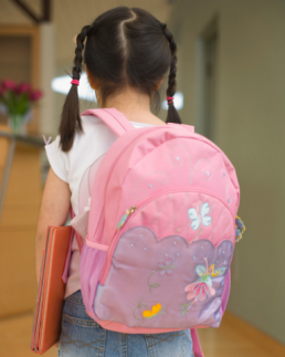 photo of little girl with a pink backpack